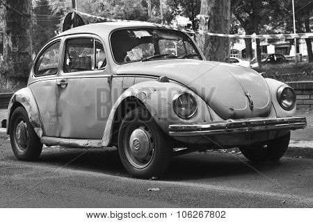 Milan, Italy-august 9, 2014: German Motor Car Volkswagen Beetle Parked In The City
