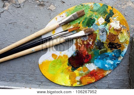 Brushes And Colorful Abstract Oil Colors Paiters Pallet, On Grunge Background