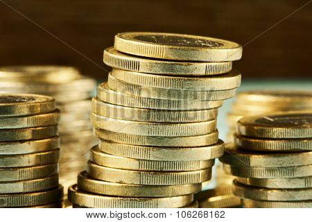 closeup of some piles of coins of one euro