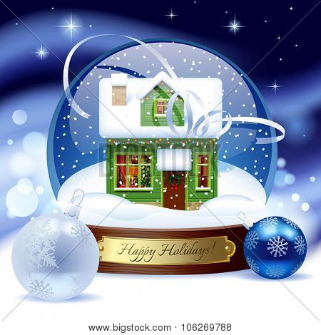 Snow globe with green wooden christmas house with decorations against a blue snow storm background. Christmas and New Year greeting card