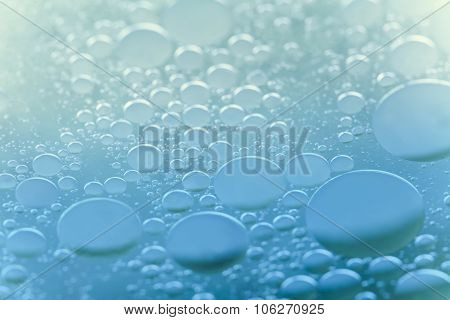 Bubbles experiment in laboratory. abstract liquid macro view