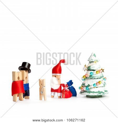 creative congratulatory xmas postcard. Wooden clothespin Santa Claus, man, woman and child