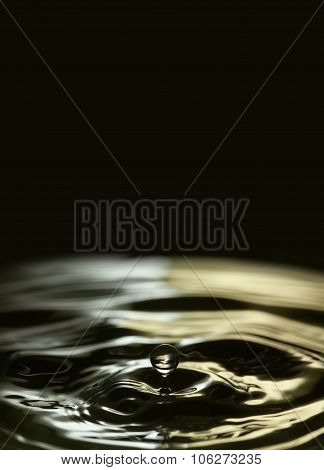 Falling water drop poster template. Liquid drops. splashing. gold, black, white waves.