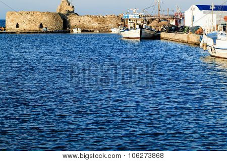Naoussa fishing port with old Venetian castle, Paros Island, Greece