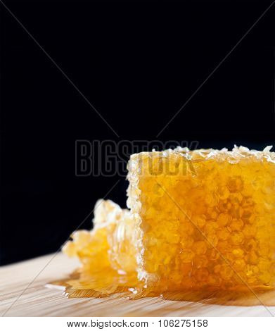 Organic yellow, gold honeycomb texture with fresh honey. closeup
