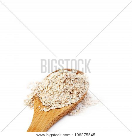 Oat flakes in retro style wooden spoon.  Breakfast food concept. white background