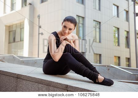 Pretty Attractive Ballerina Sitting On The Balusters