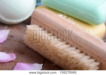 Soap, Comb, Sea Salt, Spa Stones And Flower Petals On Wooden Table, Close Up