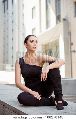 Graceful Attractive Ballerina Sitting On The Balusters