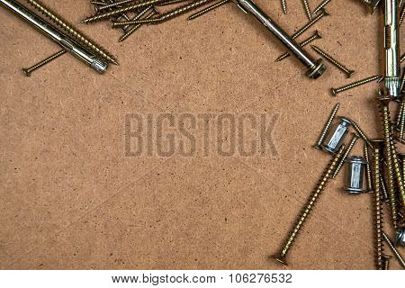 Gold screws on top and right