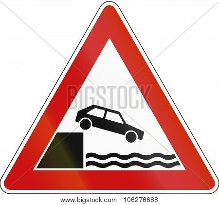 A Road Warning Sign In Germany: Quayside Or River Bank