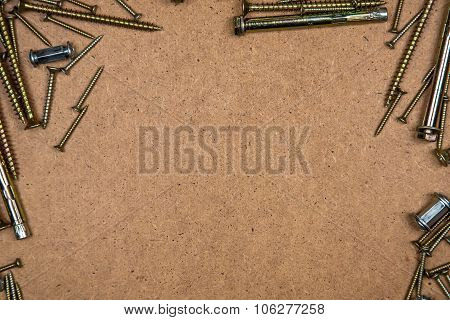 Gold screws on top left and right