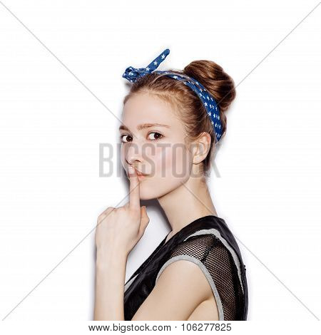 Girl With Finger On Her Lips Showing To Keep Silence