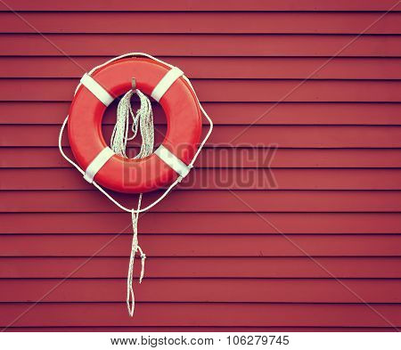 Ring Buoy On Red Wooden Wall