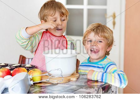 Two Little Kid Boys Baking Apple Cake Indoors