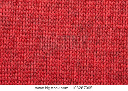 Real red knitted fabric made of heathered yarn textured background
