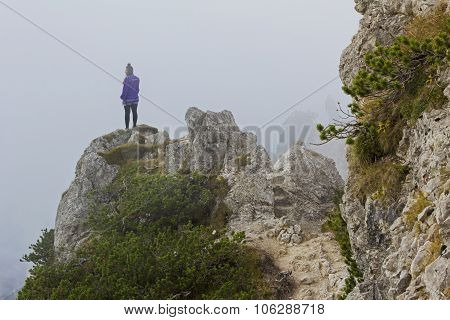 Young Woman, On A Tightrope Walk In The Bavarian Alps