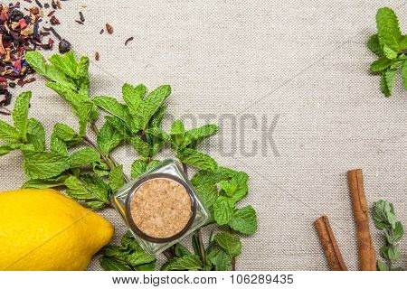 herbs for tea and lemon on a linen background