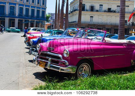 HAVANA, CUBA - JULY 25, 2013: Old classic retro Chevrolet cars on the street of Old Havana, Havana, Cuba. This is the most common mode of transportation for locals and tourists and are used a