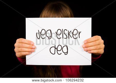 Child Holding Sign With Norwegian Words Jeg Elsker Dig - I Love You