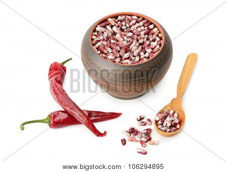 Beans in pot and hot peppers