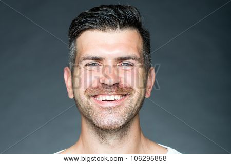 Shaven Man Smiling With Bristle