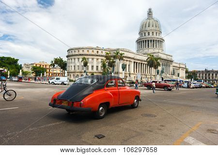 HAVANA, CUBA - JULY 16, 2013: Classic american car and Capitolio landmark in Old Havana,Cuba. Havana is tourist most popular destination and a capital of Cuba.