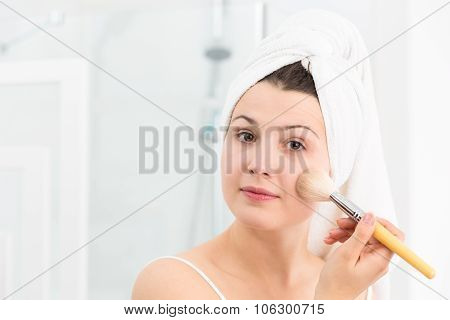 Female Applying Face Powder