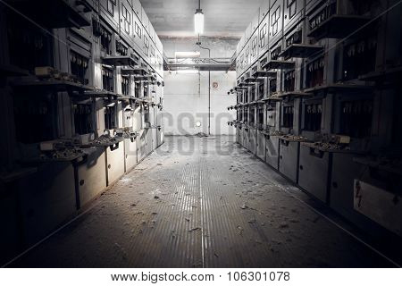 Old electrical switchboards in an abandoned factory