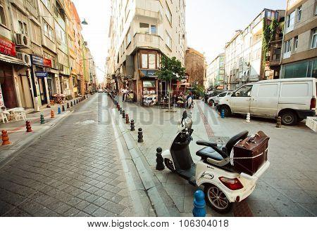 Old Motorbike Standing Between Historical Buildings Of Istanbul
