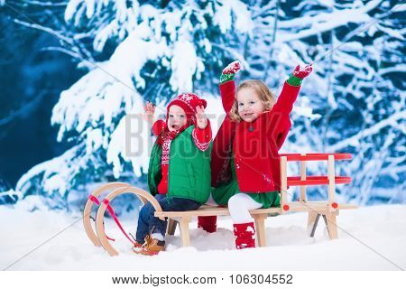 Kids Having Fun On A Sleigh Ride In Winter
