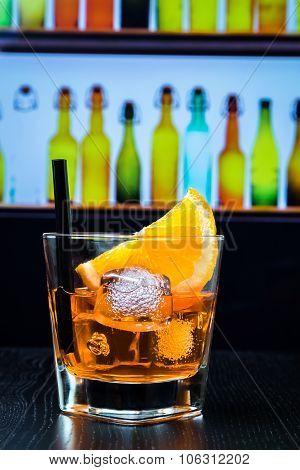 Glass Of Spritz Aperitif Aperol Cocktail With Orange Slices And Ice Cubes On Bar Table, Disco Lounge