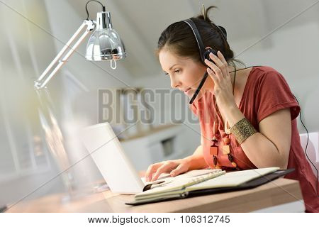 Woman telemarking assistant working from home