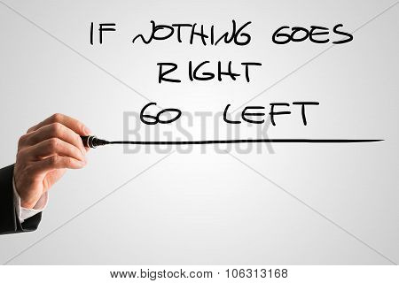 Male Hand Writing An If Nothing Goes Right Go Left Message