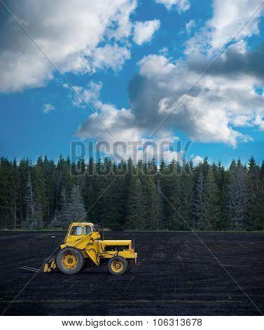 Yellow Tractor On Dark Field