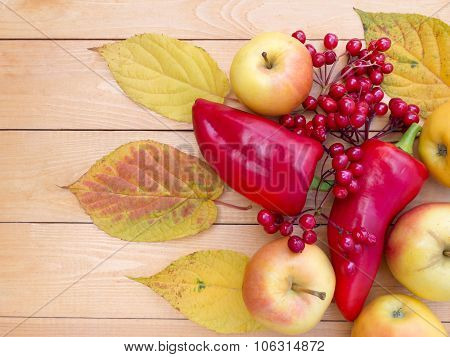 Apples, Bell Peppers, Red Viburnum Berries And Autumn Leaves
