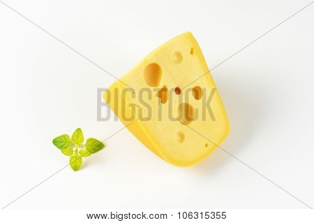wedge of fresh cheese on white background