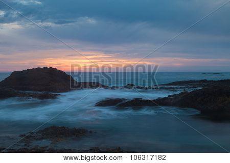 Long exposure of rocks in waves