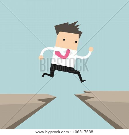 Businessman jump through the gap from one cliff to another