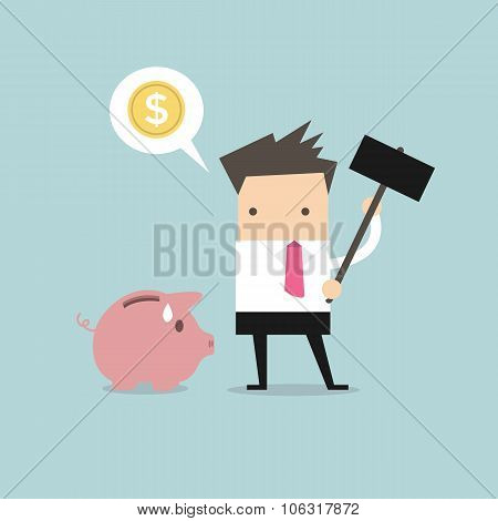Businessman try to brake piggybank