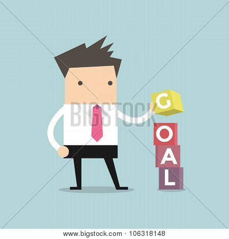Businessman is building GOAL cubic box puzzle