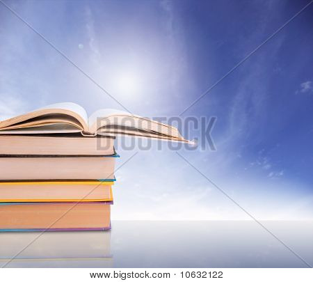 Stack of books with sun light