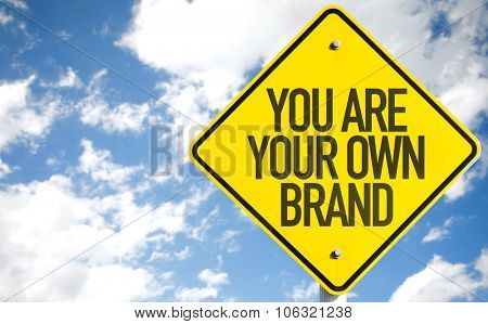 You Are Your Own Brand sign with sky background