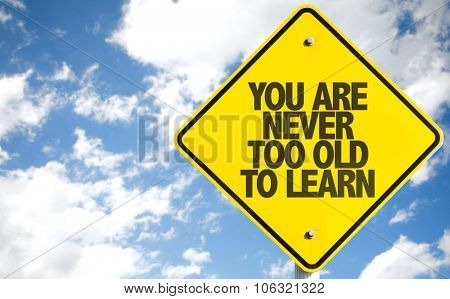 You Are Never Too Old to Learn sign with sky background
