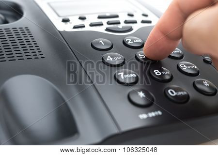 Man Dialing A Black Telephone Close Up