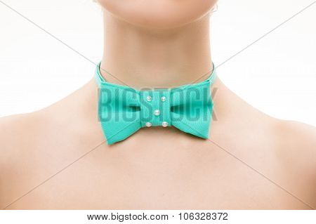 green tie bow on female neck.