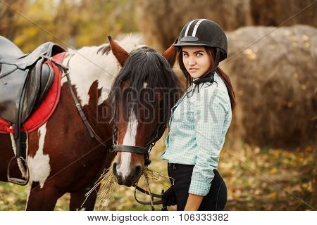 Young woman on countryside with horse for riding