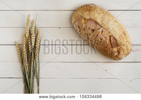 Loaf Of Bread On A Wooden White Table