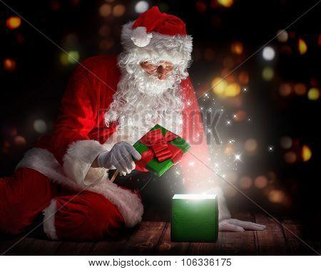 Santa Claus opening a magic gift box.