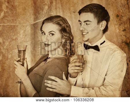 Couple on party drinking champagne . Black and white retro style.